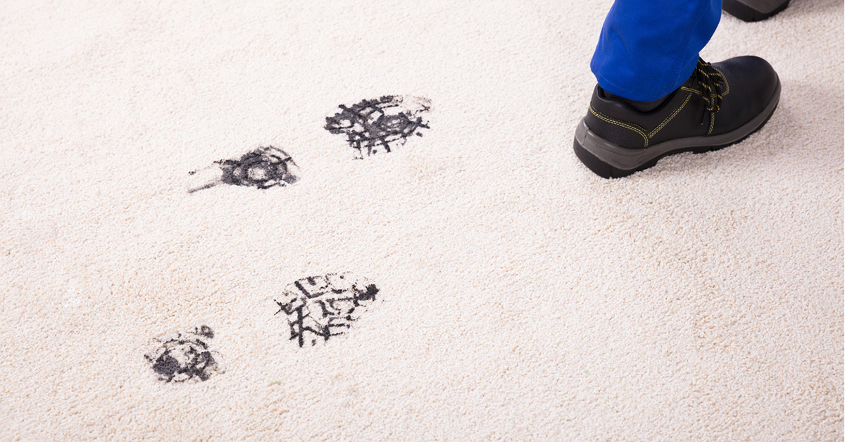 Dirty footprints on carpet