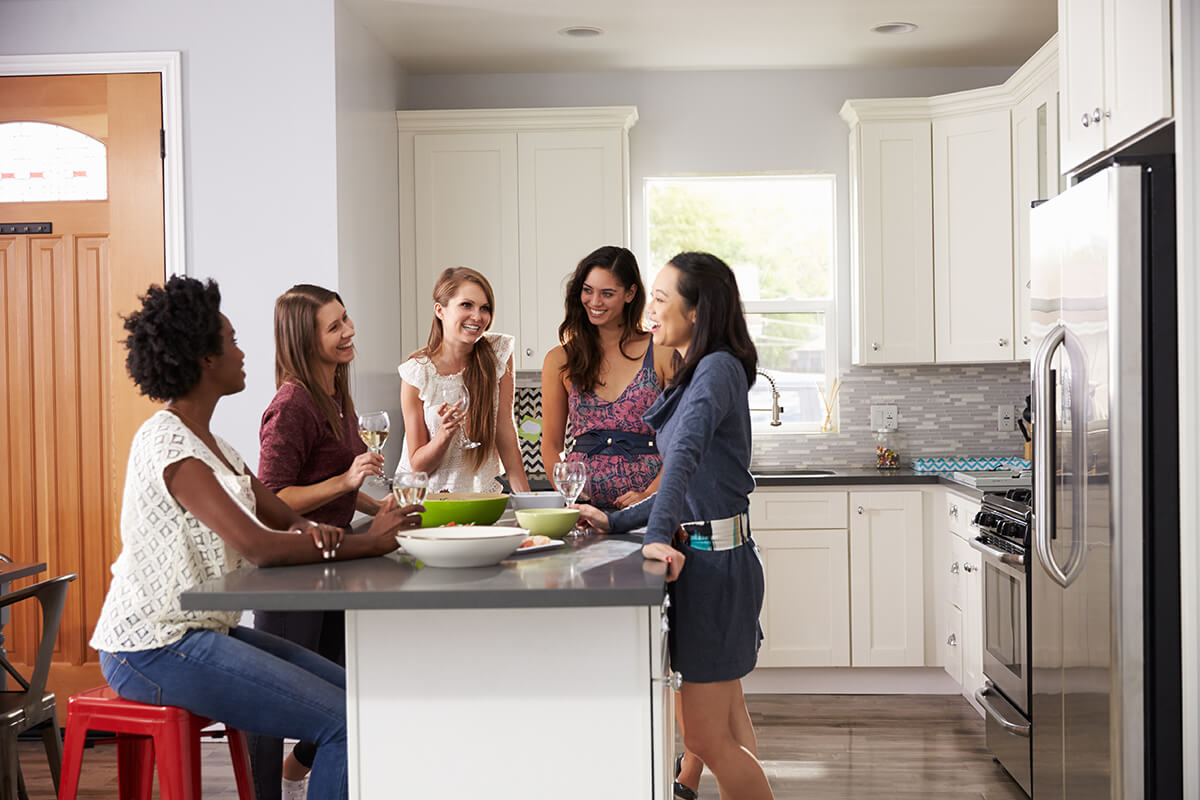 Group of women socializing in the kitchen