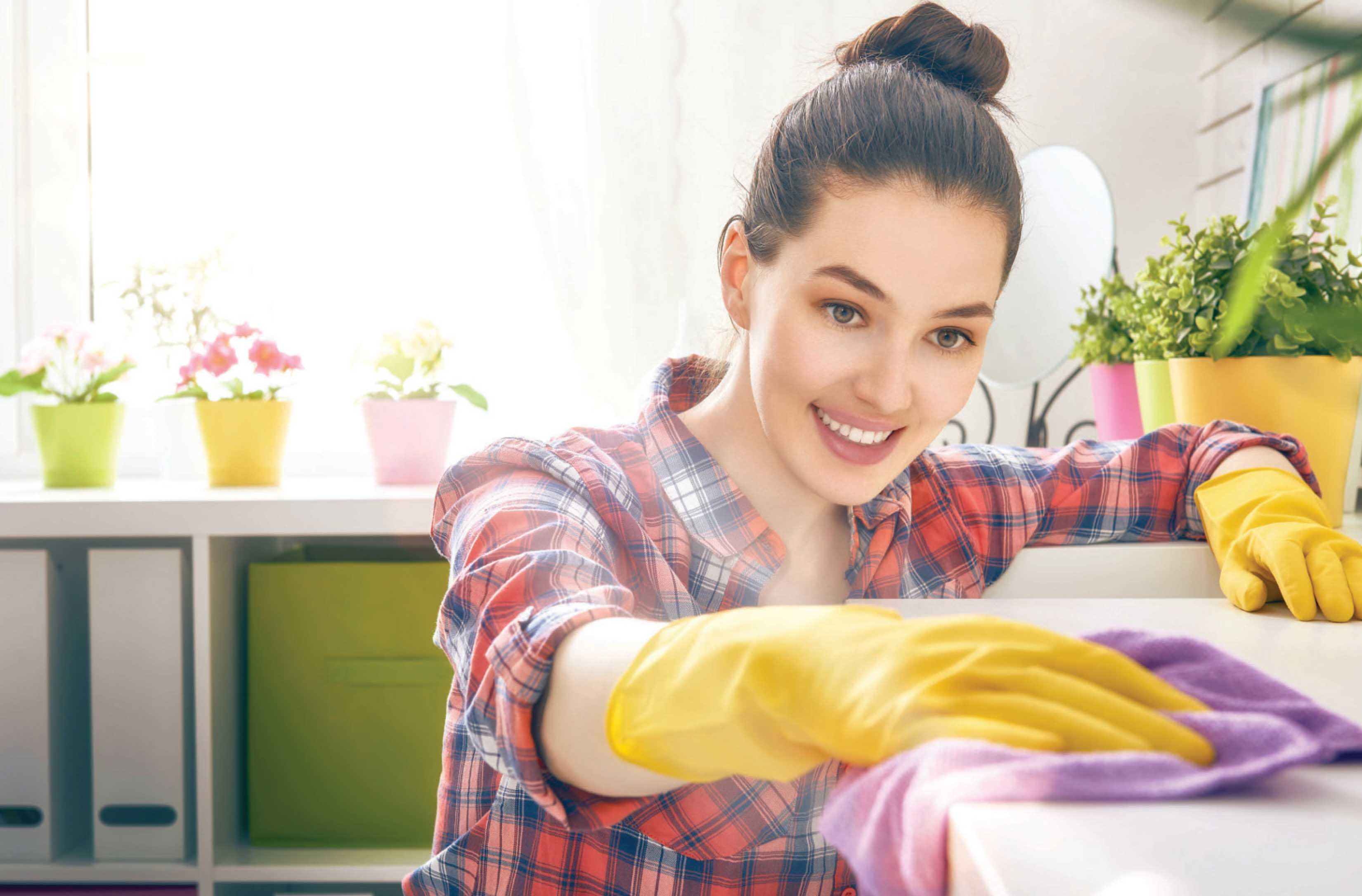 Woman cleaning counter top