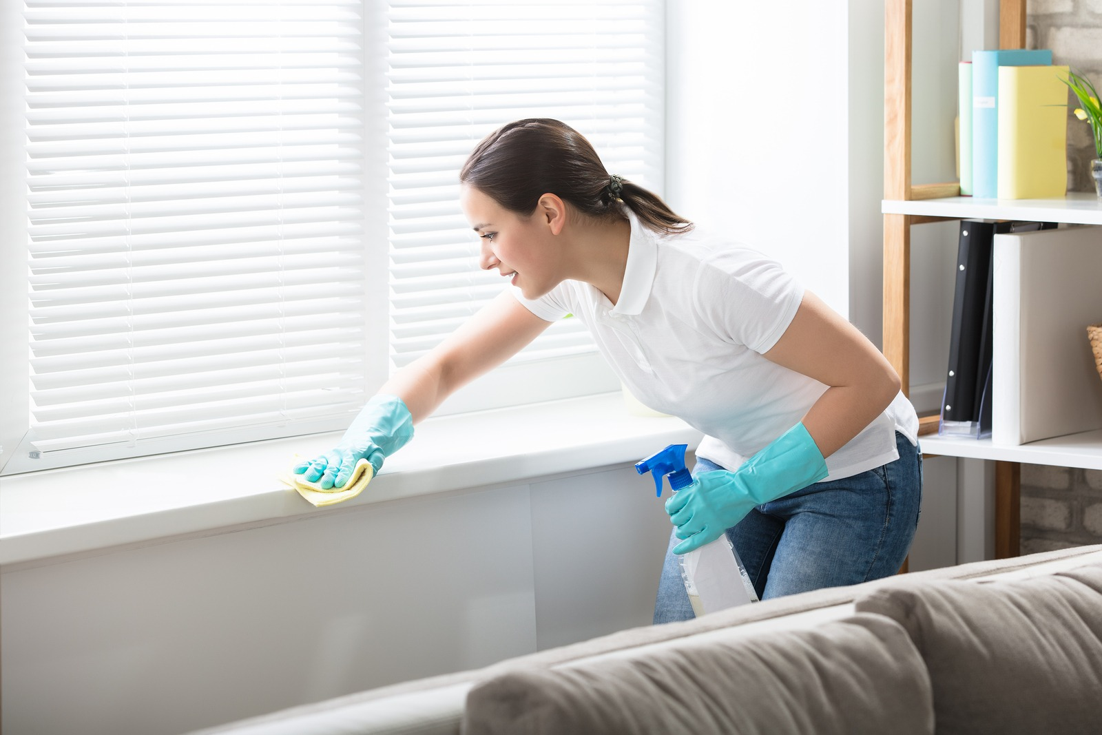 Woman cleaning inside a home